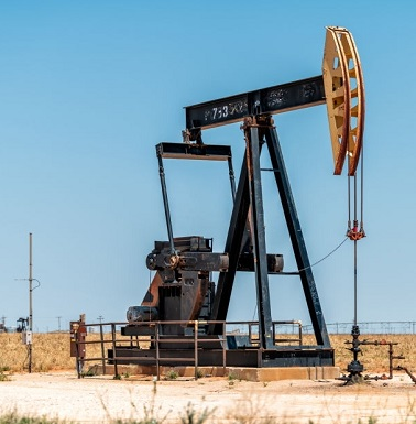 Plains, USA - June 8, 2019: Pumpjack on Oilfields in prairies of Texas with machine pumping oil